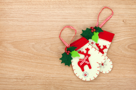 Christmas mitten decor on wooden background with copy space photo