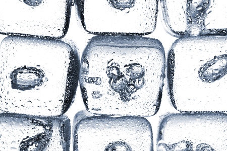 cold background: Melting ice cubes with air bubbles inside on white background Stock Photo