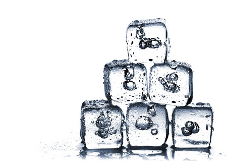 Melting ice cubes with air bubbles inside on white background photo