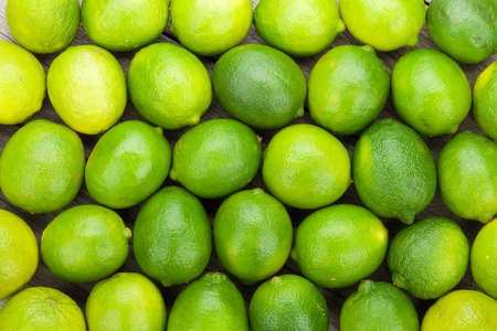 Fresh ripe limes on wooden table photo