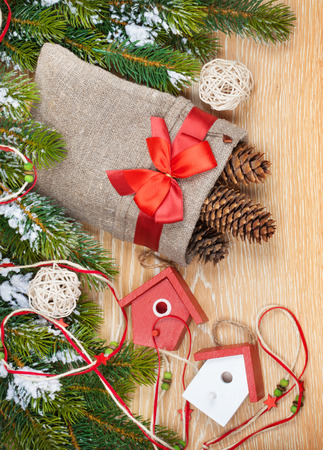 Christmas wooden background with snow fir tree, decor photo