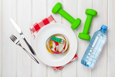 bodies of water: Dumbells and healthy food over wooden background. View from above Stock Photo
