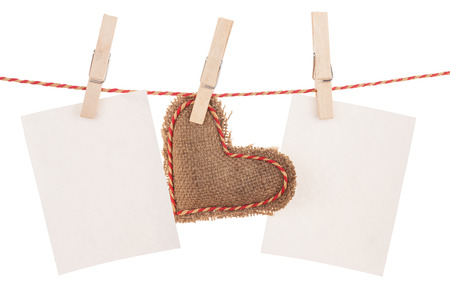Photo frames and valentines day toy heart hanging on rope. Isolated on white background photo