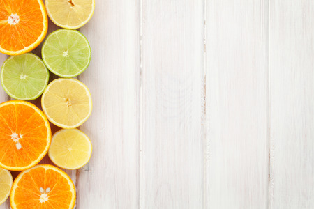tangerines: Citrus fruits. Oranges, limes and lemons. Over wood table background with copy space Stock Photo
