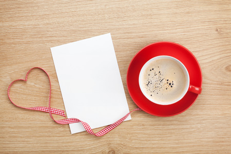wedding photo album: Blank valentines greeting card and red coffee cup on wooden background