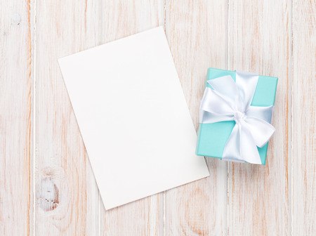 box love: Valentines day gift box and greeting card on white wooden table with copy space
