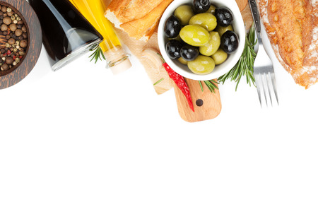 Italian food appetizer of olives, bread and spices. Isolated on white background photo