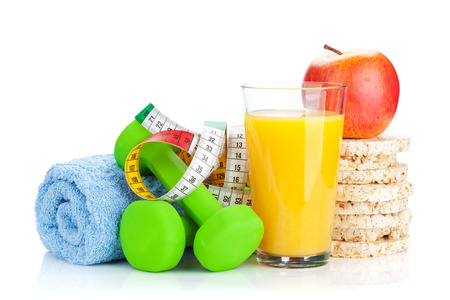 dumbell: Two green dumbells, tape measure and healthy food. Fitness and health. Isolated on white background
