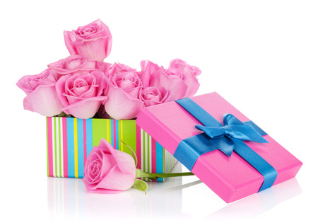 Gift box full of pink roses. Isolated on white background photo