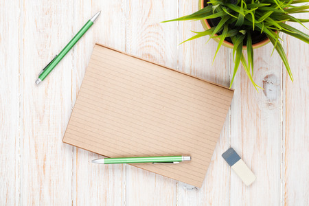 Office desk table with supplies and flower. Top view with copy space Stock Photo - 36619582