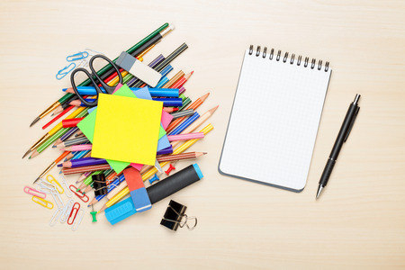 School and office supplies over office table. Top view with copy space photo