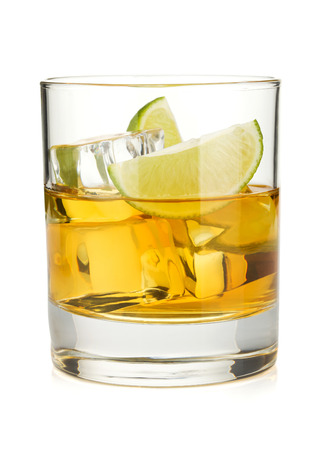 whiskey glass: Whiskey cocktail with lime. Isolated on white background