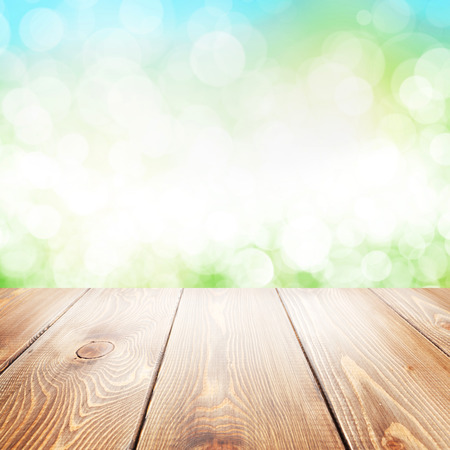 Summer nature background with wooden table and blurred bokeh photo