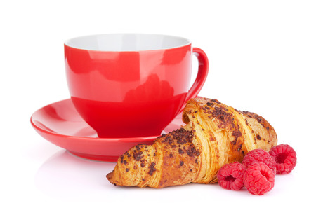 Cup of coffee, fresh croissant and berries. Isolated on white background photo