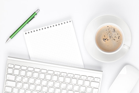 Office desk table with computer, supplies and coffee cup. Top view with copy space Standard-Bild