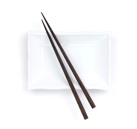 Empty plate and chopsticks. Isolated on white background photo