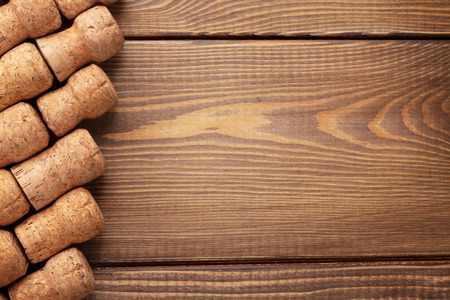 brown background: Champagne wine corks over wooden table background with copy space