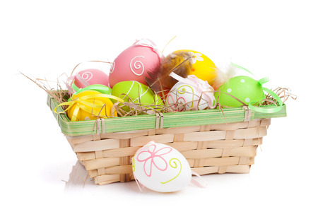 Easter eggs basket. Isolated on white background