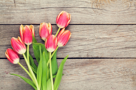 red tulip: Colorful tulips on wooden table. Top view with copy space