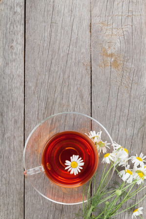 Herbal tea with chamomile flower on wooden table background with copy space Stock Photo