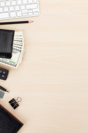 office space: Office table with pc, supplies and money cash. View from above with copy space Stock Photo