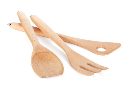 Wooden kitchen utensils. Isolated on white background photo