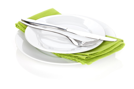 flatware: Silverware or flatware set of fork and knife over plates. Isolated on white background Stock Photo