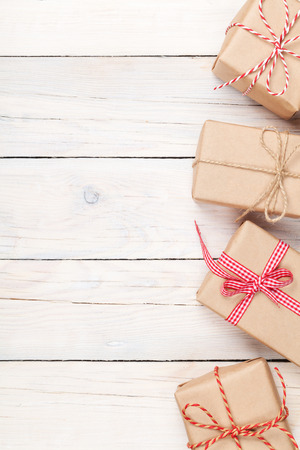 Gift boxes on wooden table background with copy space Stockfoto