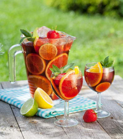 Refreshing fruit sangria (punch) on wood table Archivio Fotografico