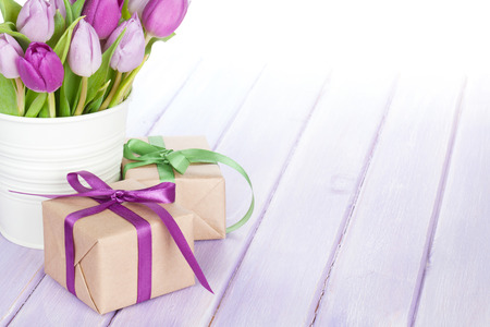 white tulip: Purple tulip bouquet and gift box on wooden table with copy space