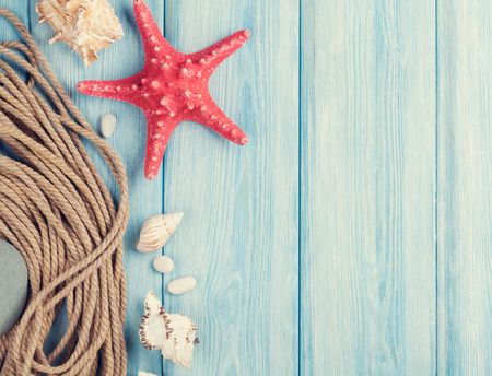 rope: Summer time sea vacation background with star fish and marine rope. Retro toned Stock Photo