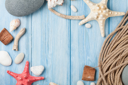 Summer time sea vacation background with star fish and marine rope photo