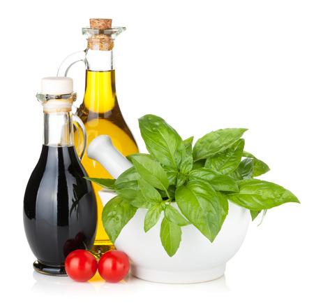 vinegar bottle: Olive oil, vinegar bottles with basil and tomatoes. Isolated on white background