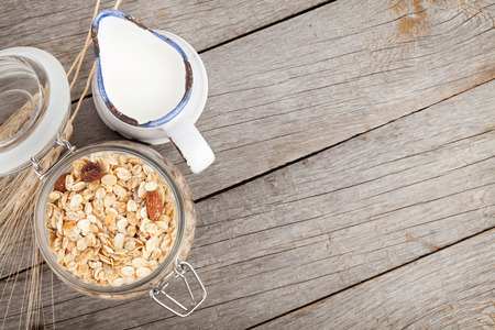 Healthy breakfast with muesli and milk. View from above on wooden table with copy space Stockfoto