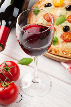 vinegar bottle: Pizza and red wine on wooden table background Stock Photo