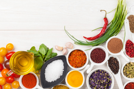 spices: Various spices on white wooden background. Top view with copy space