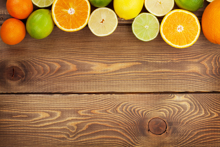 lemon: Citrus fruits. Oranges, limes and lemons. Over wooden table background with copy space