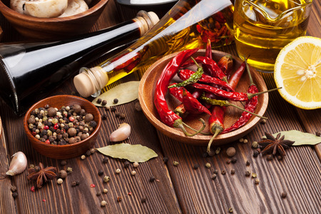 chili powder: Various spices on wooden background Stock Photo