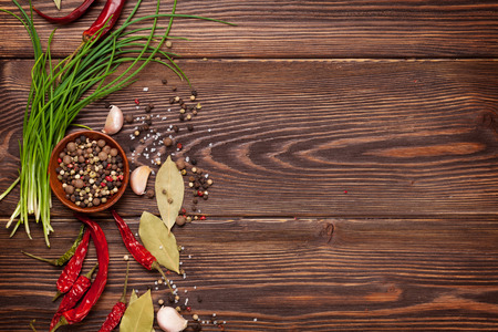 ingredient: Various spices on wooden background. Top view with copy space