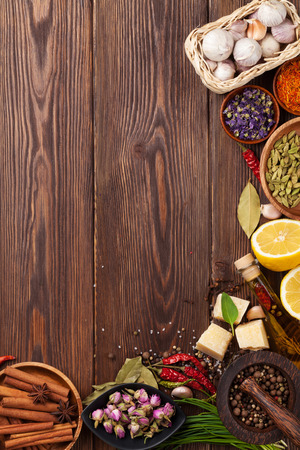 indian spice: Various spices on wooden background. Top view with copy space