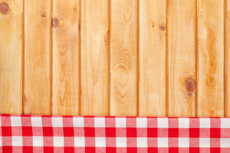 Red towel over wooden kitchen table. View from above with copy space photo