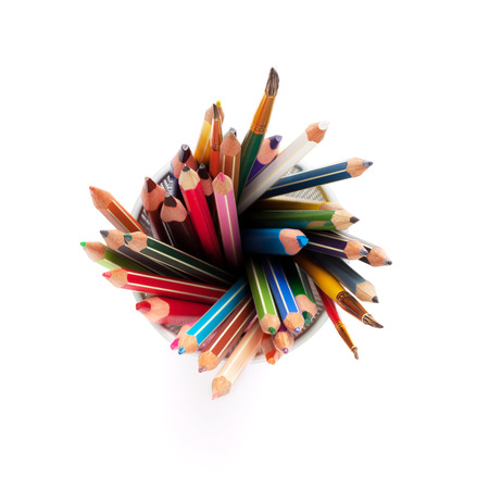 pencil holder: Colorful pencils and brushes in holder. Isolated on white background. Top view