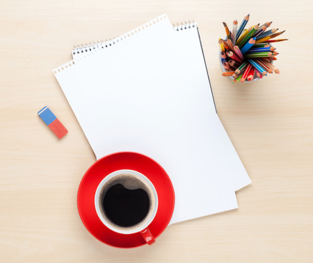office space: Office desk table with supplies and coffee cup. Top view with copy space