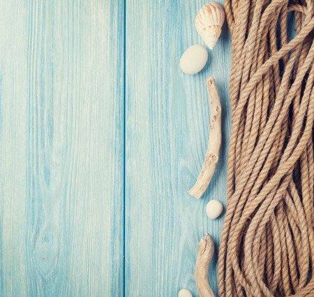 blue toned: Summer time sea vacation background with marine rope. Retro toned