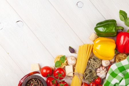 Italian food cooking ingredients. Pasta, tomatoes, peppers. Top view with copy space