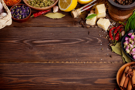 indian spices: Various spices on wooden background. Top view with copy space