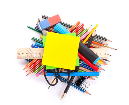 pen and paper: School and office supplies heap. Isolated on white background