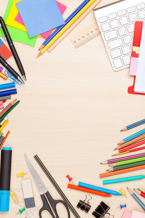 office space: School and office supplies over office table. Top view with copy space Stock Photo