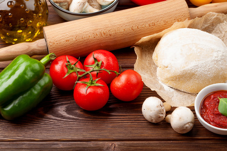 Pizza cooking ingredients. Dough, vegetables and spices Banco de Imagens