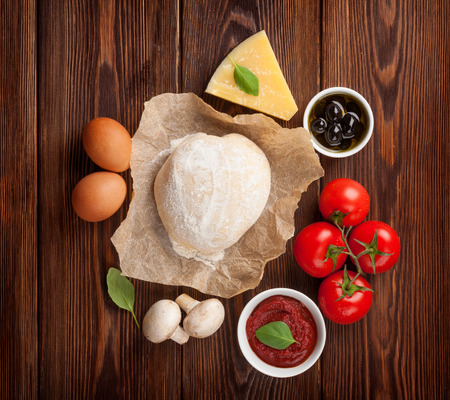 Pizza cooking ingredients. Dough, vegetables and spices photo